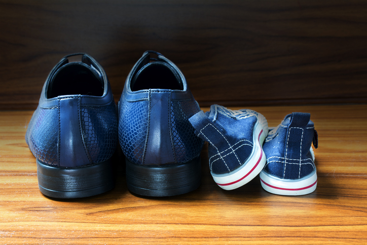 Men shoes and children sneakers side by side, father's day