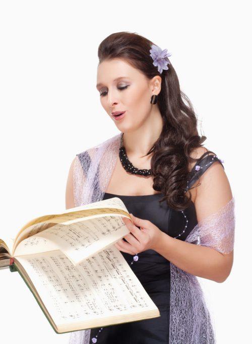Opera Singer Singing in her Stage Dress