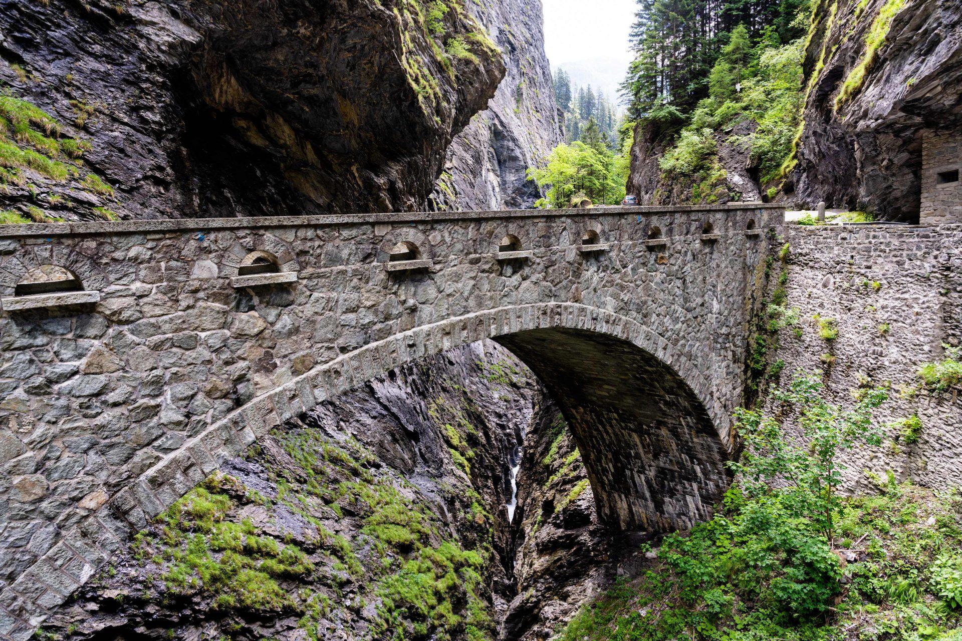historic stone bridge crossing the deep Viamala Gorge in the Swiss Alps near Thusis