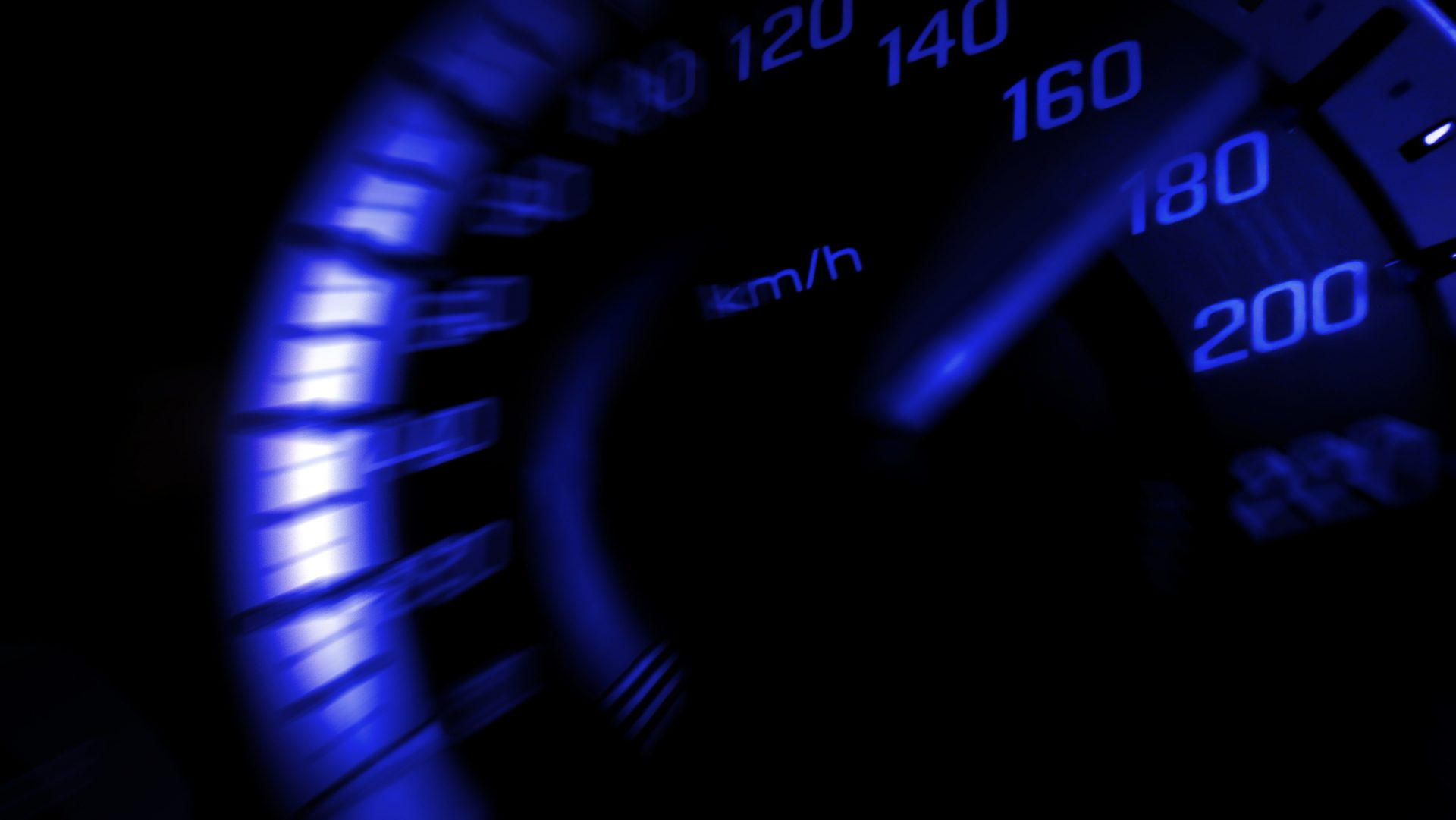 Close up shot of a speed meter in a car with blue light speed at 180 Km/H in concept racing car