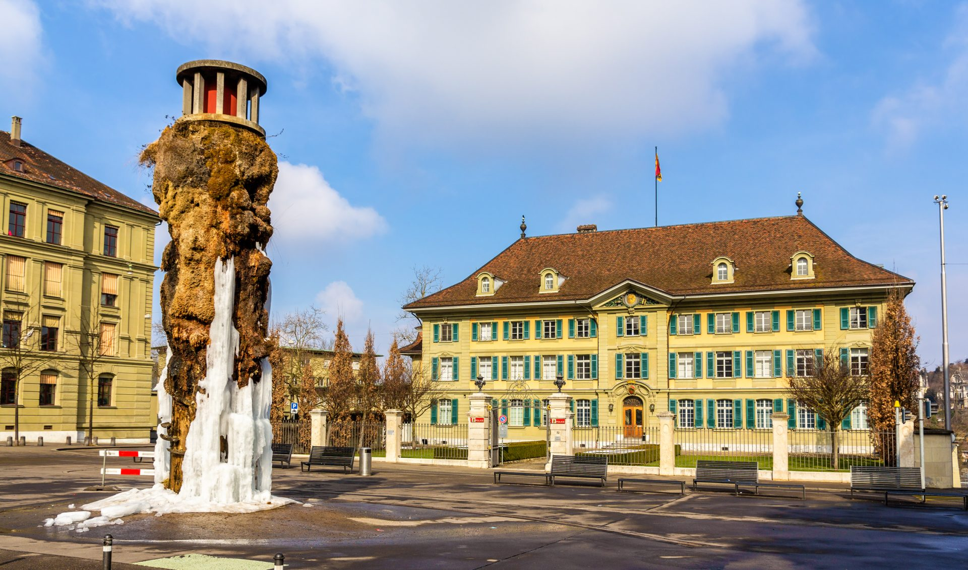 Frozen Meret Oppenheim Fountain and Police office in Bern