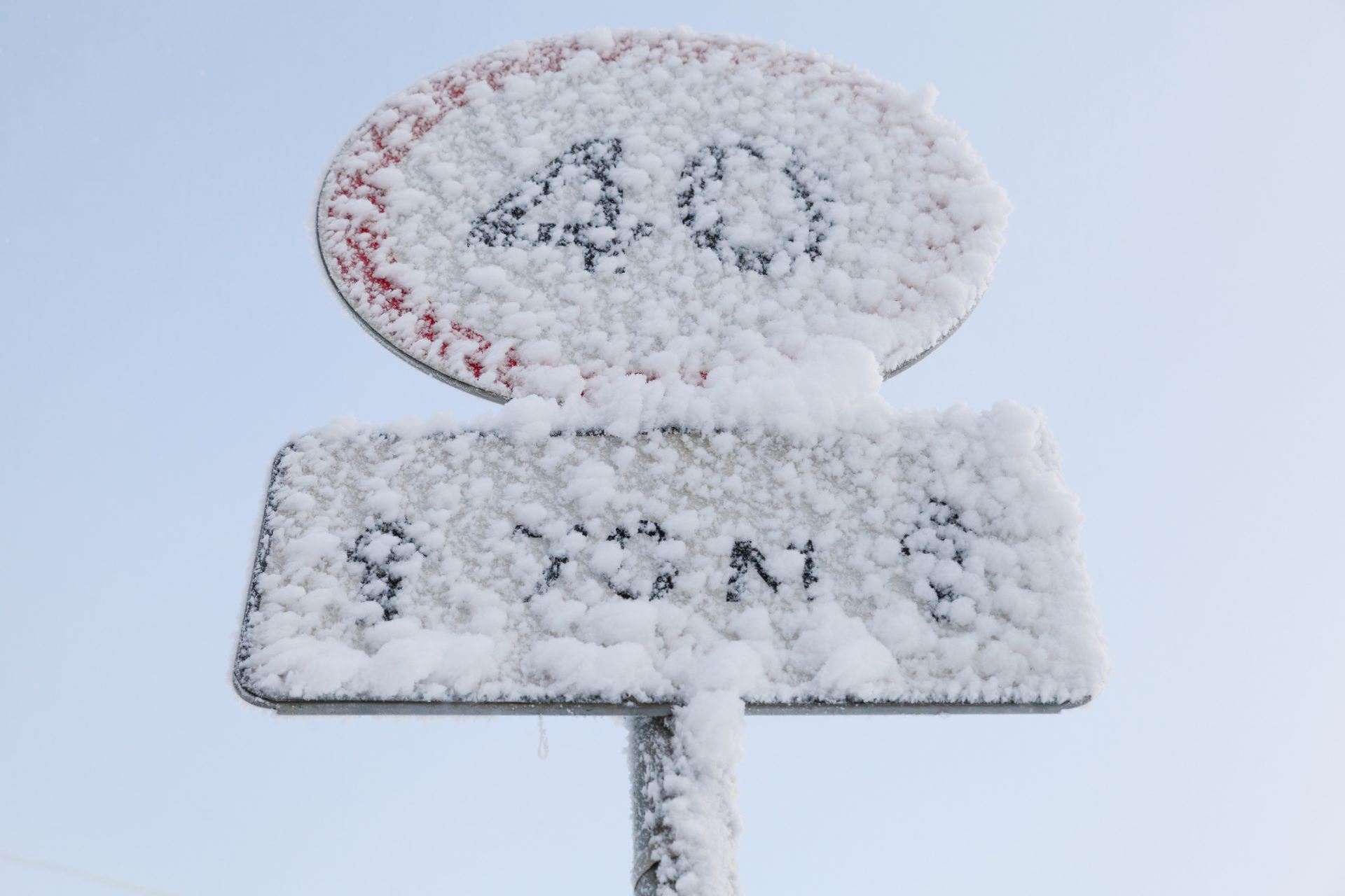 Frosted speed limit road sign in winter