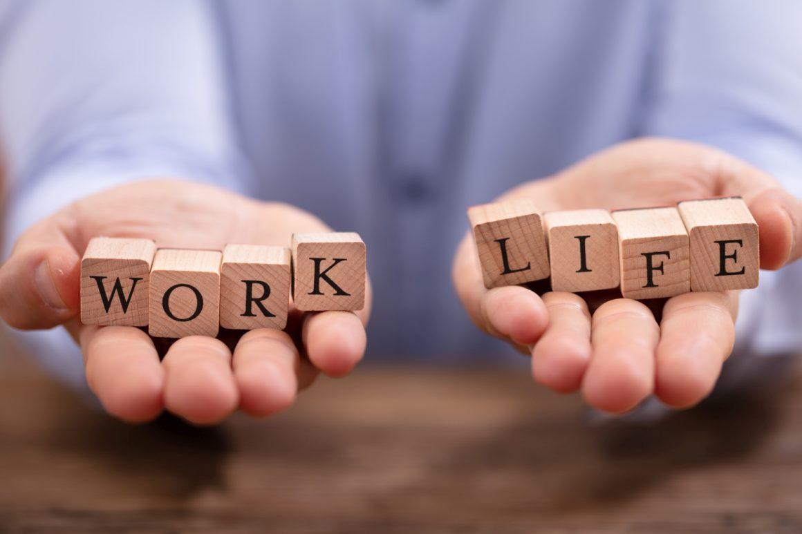 Businessman Balancing Work And Life Blocks