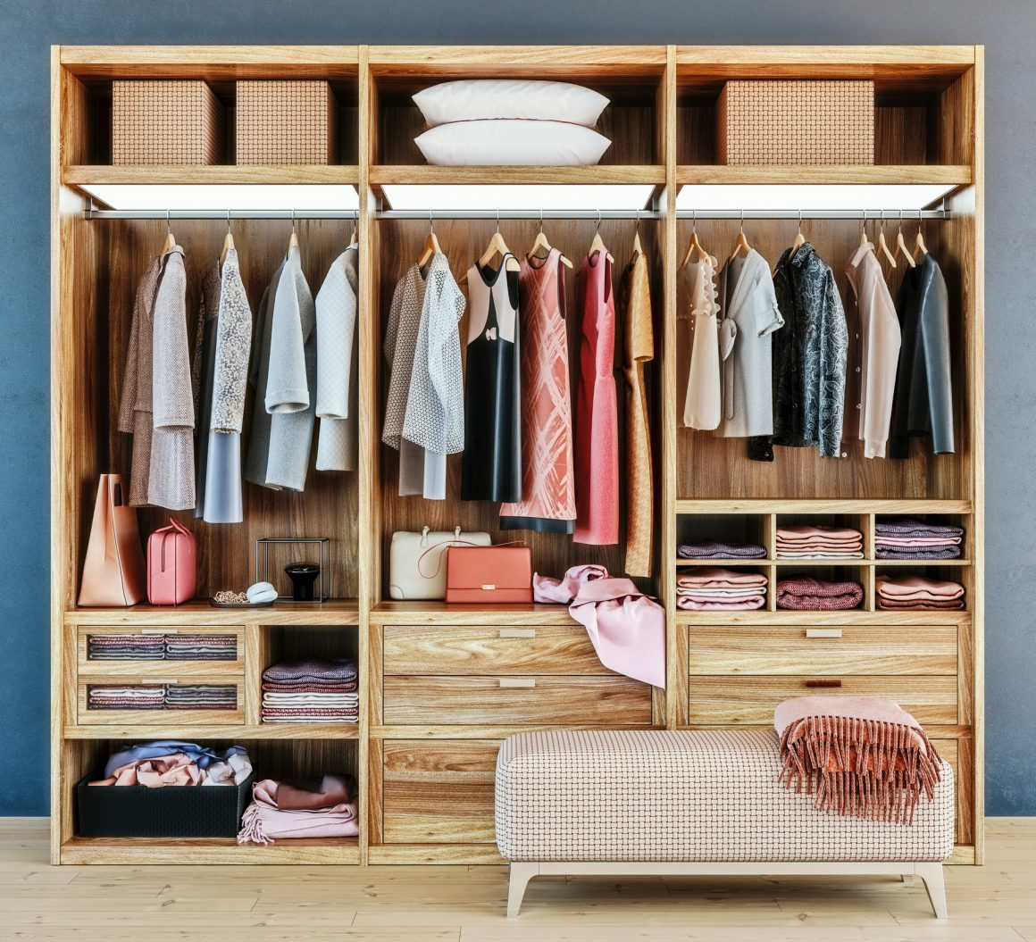 modern wooden wardrobe with clothes hanging on rail in walk in closet design interior, 3d rendering