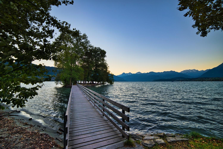 View of Lake Thun and the island of Grunderinseli just before sunrise on Lake Thun
