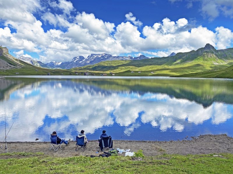 Fishermens on the artificial alpine lake Melchsee or Melch lake in the Uri Alps mountain massif, Melchtal – Canton of Obwalden, Switzerland (Kanton Obwald, Schweiz)
