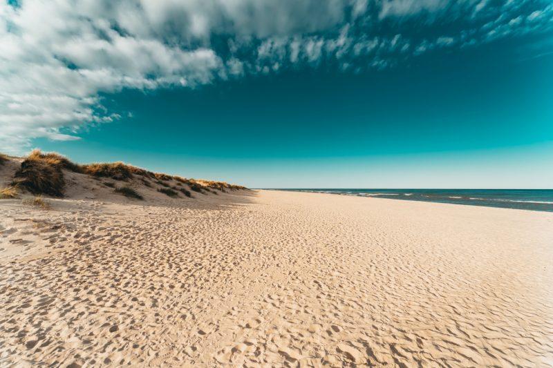 Amazing white sand beach in Sandhammaren, Sweden. Popular tourist destination in summer.